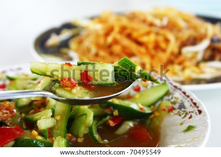 Close up of a Spoon of  Green Cucumber salad. thai food - stock photo