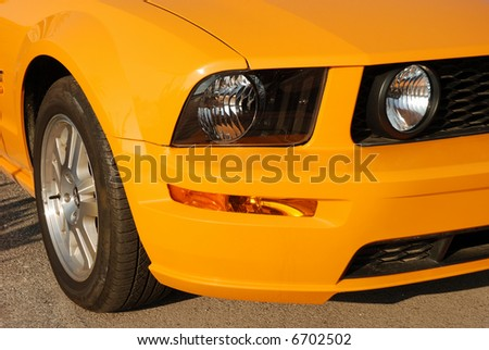close up of a sports car lights and wheel - stock photo
