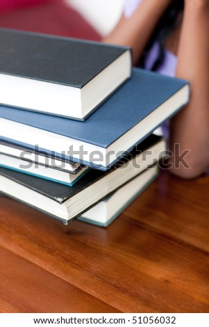 Close-up of a stack of books on a table