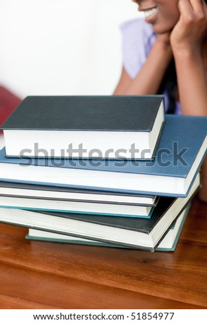 Close-up of a stack of books on a table - stock photo