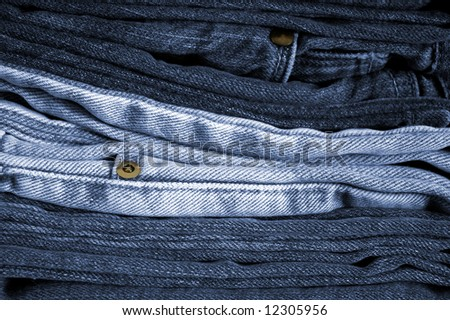 Close-up of a stack of folded blue jeans - stock photo