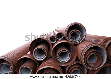 close up of a stack of pipes isolated in white - stock photo