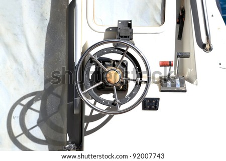 Close up of a steering wheel of the ship made of a metal - stock photo