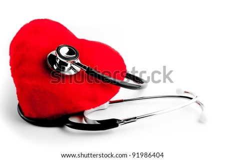 close up of a stethoscope and heart on white background - stock photo