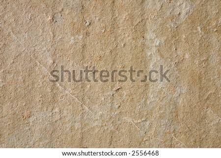 Close-up of a stone wall; rough texture - stock photo