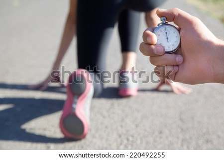 close-up of a stopwatch in hand man for measuring the running speed of the athlete - stock photo