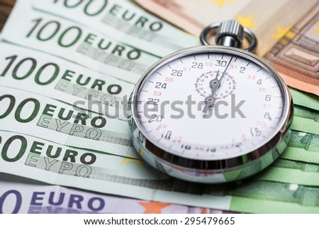 Close-up Of A Stopwatch On Euro Banknotes
