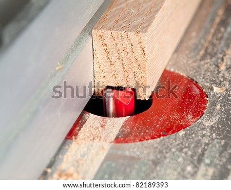 Close up of a straight router bit cutting a groove or rabbet in a piece of oak - stock photo