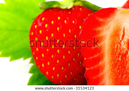 Close up of a strawberry with half of strawberry on front. Half of strawberry in the focus. - stock photo
