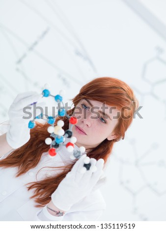 close-up of a student in a chemistry lab analyzing DMT molecular model