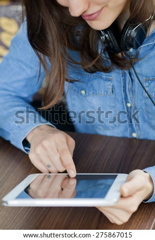 Close up of a student working on the digital tablet - stock photo