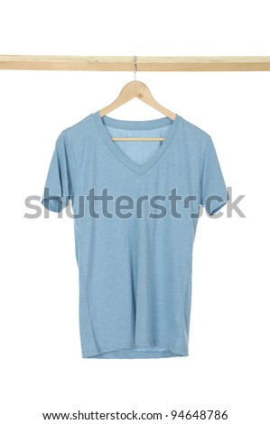 close up of a t shirt on cloth wooden hangers in row - stock photo