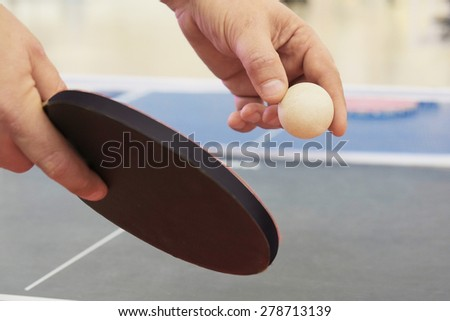 Close up of a table tennis player serving - stock photo
