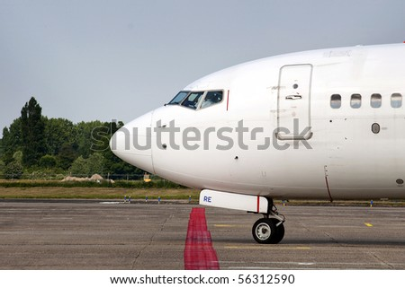 Close up of a taxiing commercial airliner, ready for departure - stock photo