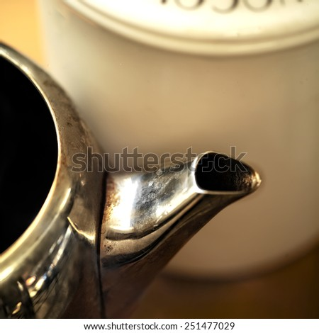 Close up of a Teapot Spout, indoor shot with shallow DOF