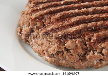 Close up of a thick ground sirloin patty - stock photo