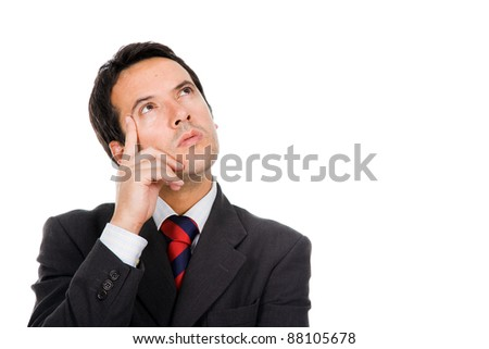 Close-up of a thoughtful young business man against white background - stock photo