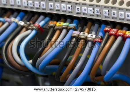 Close up of a three phase power supply electrical wiring and terminals. - stock photo