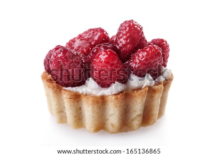 close-up of a tiny tart with raspberry on top isolated on white background. High resolution  - stock photo