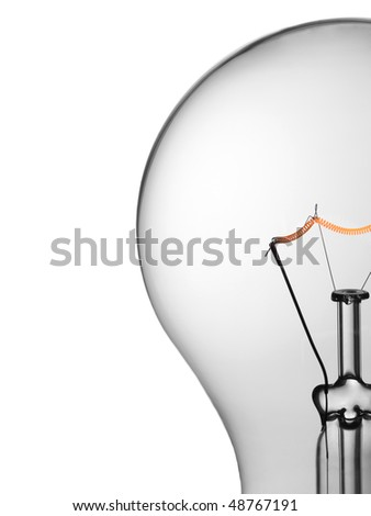 Close up of a transparent light bulb over a white background.