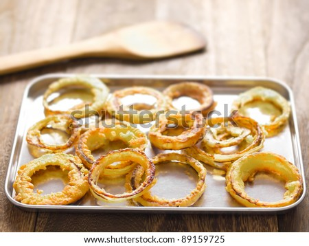 close up of a tray of onion rings - stock photo