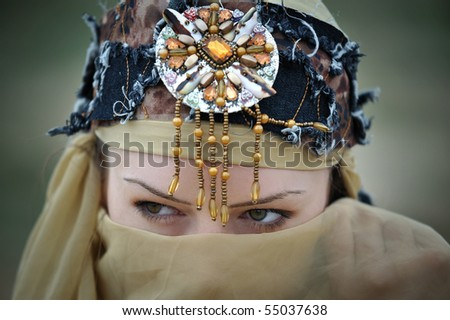 Close-up of a tribal woman hiding her face looking sideways