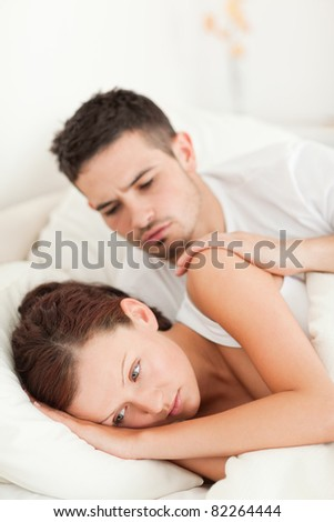 Close up of a Unhappy couple in their bedroom