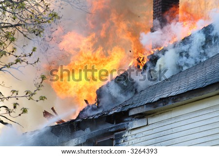 close-up of a urban roof top on fire - stock photo