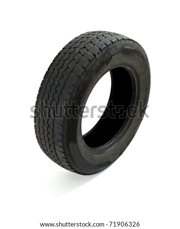 close up of a used car tire on white background - stock photo
