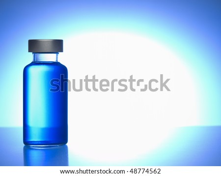 Close up of a vial filled with blue liquid. Copy space. - stock photo