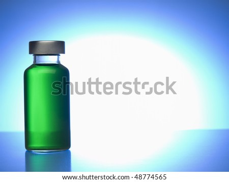 Close up of a vial filled with green liquid. Copy space. - stock photo
