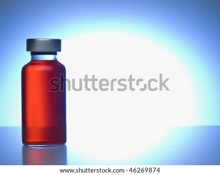 Close up of a vial filled with red liquid. Copy space. - stock photo