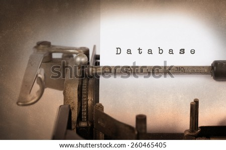 Close-up of a vintage typewriter, old and rusty, database - stock photo