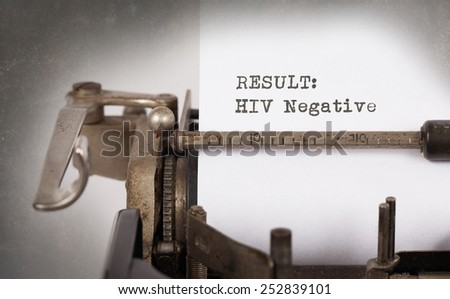 Close-up of a vintage typewriter, old and rusty, HIV negative - stock photo