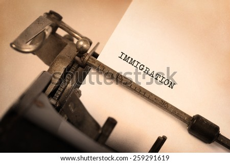 Close-up of a vintage typewriter, old and rusty, immigration - stock photo