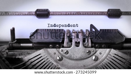 Close-up of a vintage typewriter, old and rusty, independent - stock photo