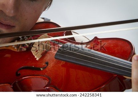 Close up of a violin being played. - stock photo