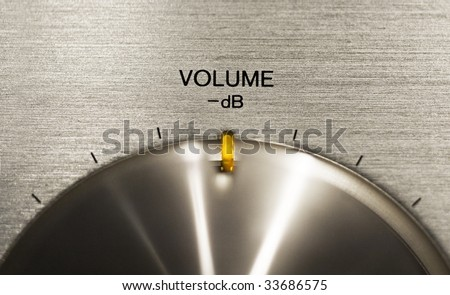 close up of a volume push button on a hi-fi - stock photo