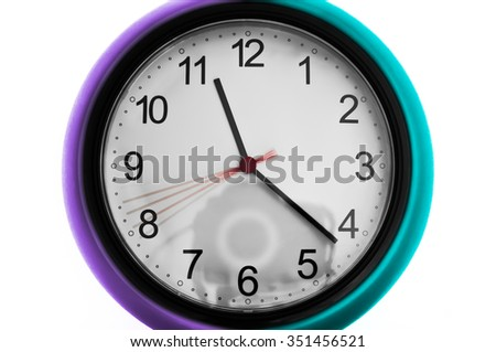 Close up of a wall clock and a reflex camera, as a concept of time of photographing - stock photo