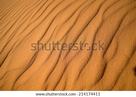 close up of a waves of sand makes by the wind of the desert - stock photo