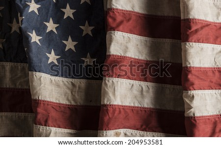 Close-up of a weathered american flag - stock photo