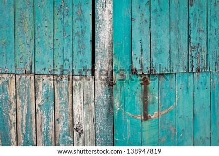Close up of a weathered blue barn door - stock photo