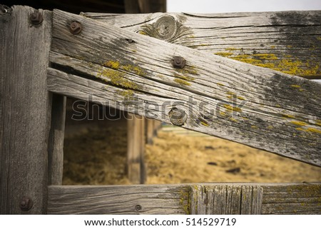 Close up of a weathered wood farm gate