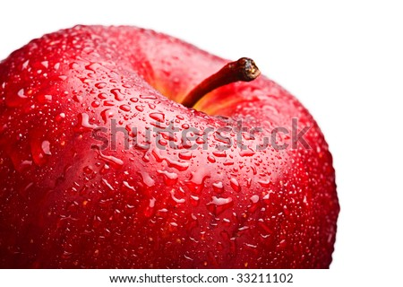 Close-up of a wet red apple against white background