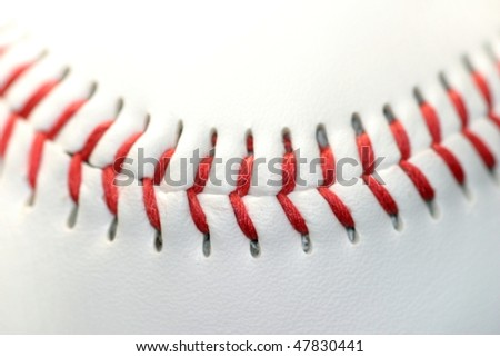 Close up of a white baseball with red seams - stock photo