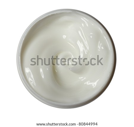 close up of a white beauty cream on white background with clipping path - stock photo