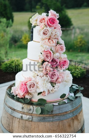 Closeup white cake decorated pink flowers stock photo edit now close up of a white cake decorated with pink flowers standing on a wooden barrel mightylinksfo
