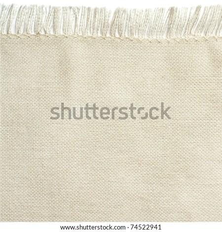 Close up of a white cotton napkin isolated on white background - stock photo