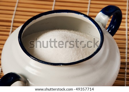 Close up of a white enamel sugar bowl - stock photo