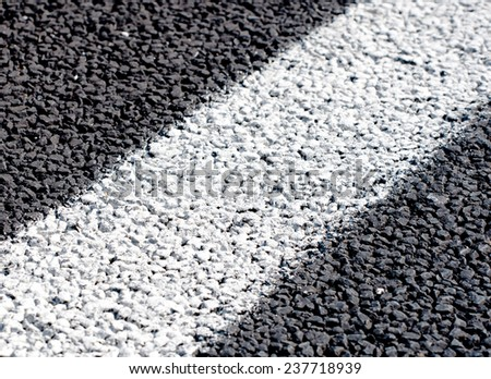 Close up of a white lines on new road. - stock photo